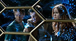 The Doctor, Amy and Rory look at a screen