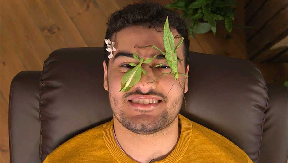 Host of Bugface Yussef Rafik, covered in bugs